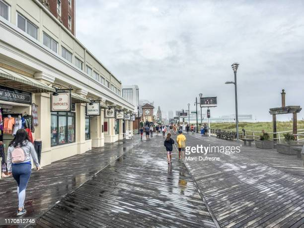 people on atlantic city boardwalk - atlantic city stock pictures, royalty-free photos & images