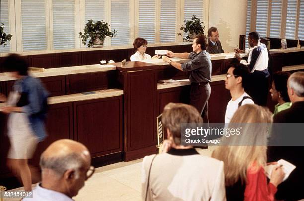 People on bank line
