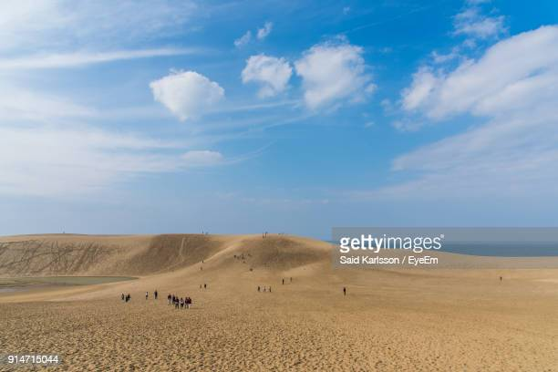people on beach against clear sky - tottori prefecture stock pictures, royalty-free photos & images