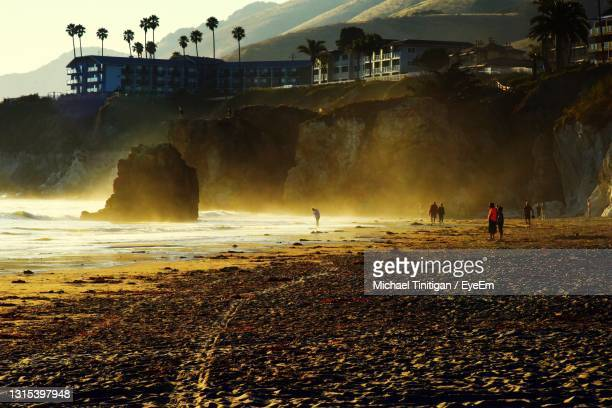 people on beach during sunset - pismo beach stock pictures, royalty-free photos & images