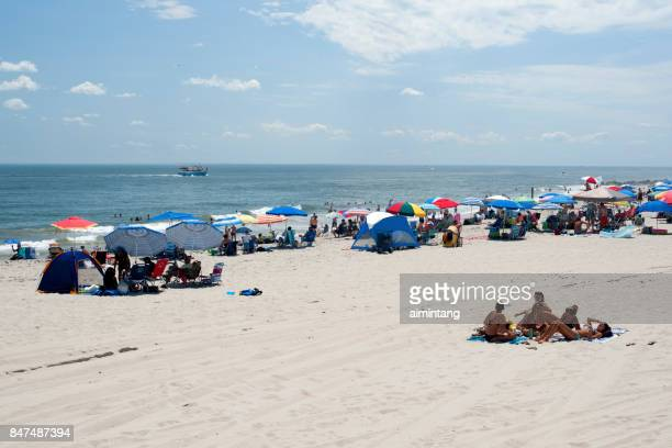 people on beach in cape may - cape may stock pictures, royalty-free photos & images