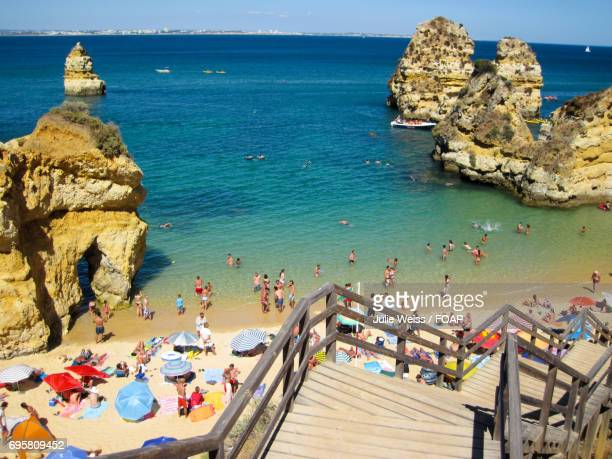 People on beach in Lagos, portugal
