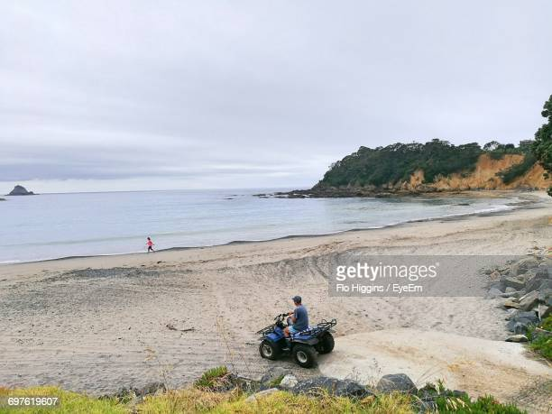 people on beach in new zealand - whangarei heads stock-fotos und bilder