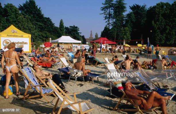 People on beach in Parco Sempione, Milan, Italy