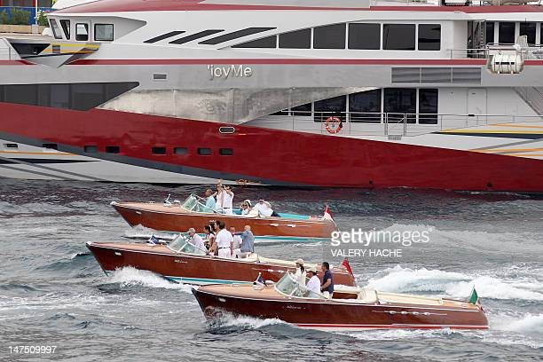 "People on board legendary Riva motorboats take part to the ""50th Parade of the Aquaramas"" a long procession in front of the Yacht Club de Monaco on..."