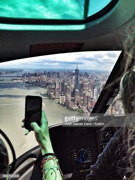 People On Board Of Aircraft Taking Pictures With Smartphone