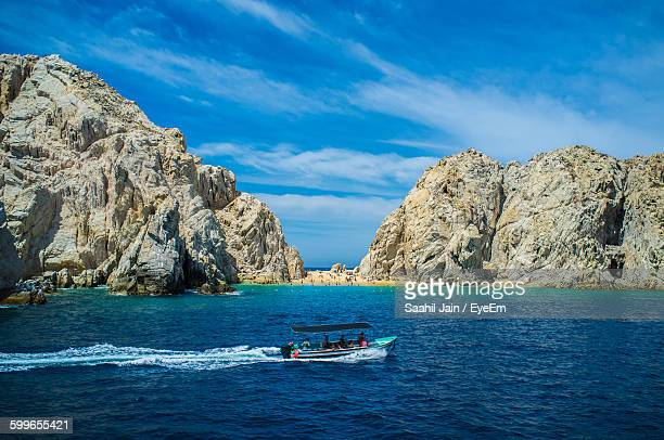 people on boat in sea against sky - cabo san lucas stock pictures, royalty-free photos & images