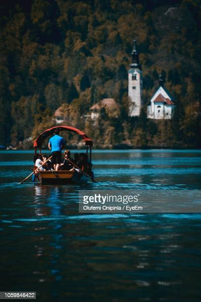 people on boat sailing in lake bled - ljubljana stock pictures, royalty-free photos & images