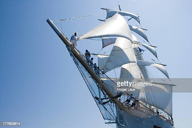 People on bowsprit of sailing ship Star Clipper