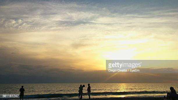 people on calm beach at sunset - captiva island stock photos and pictures