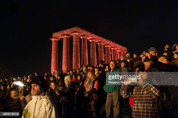 People on Calton Hill during Hogmanay's Fireworks for the start of the Hogmanay celebrations on December 30 2014 in Edinburgh Scotland