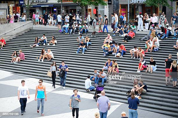 people on city square sergels torg, stockholm - stadsplein stockfoto's en -beelden