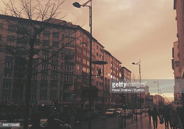 people on city street amidst building against sky - sivas stock pictures, royalty-free photos & images
