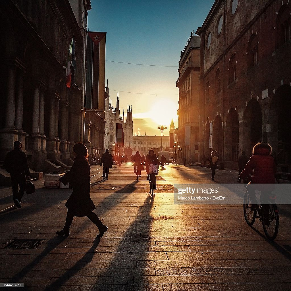 People On City Street At Sunset : Stock Photo