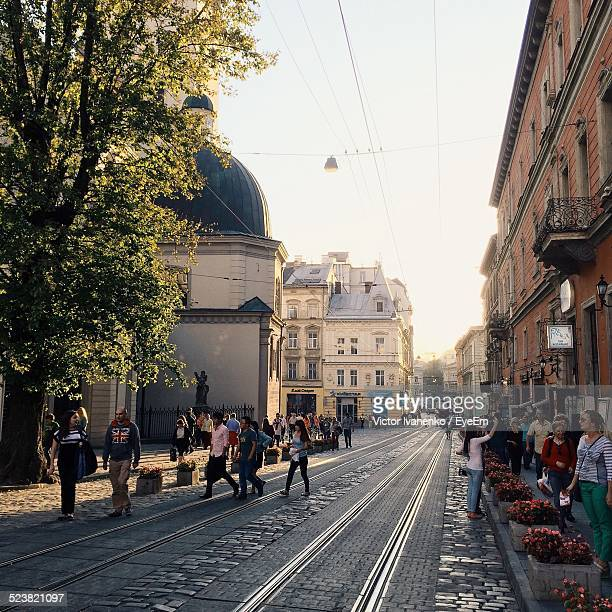 People On City Street With Tramway