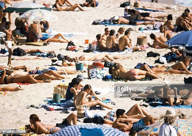 People on crowded beach, high angle view