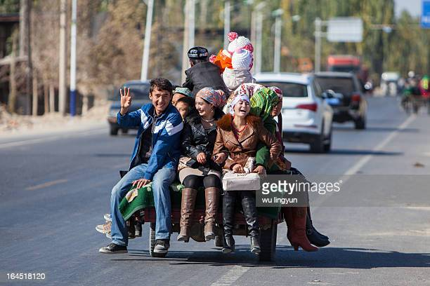 CONTENT] people on donkey cart at Yecheng countrysouth of Xinjiang