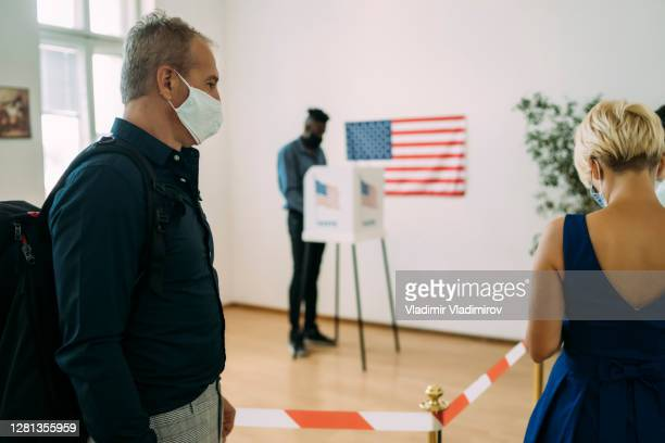 people on election day during pandemic - presidential candidate stock pictures, royalty-free photos & images