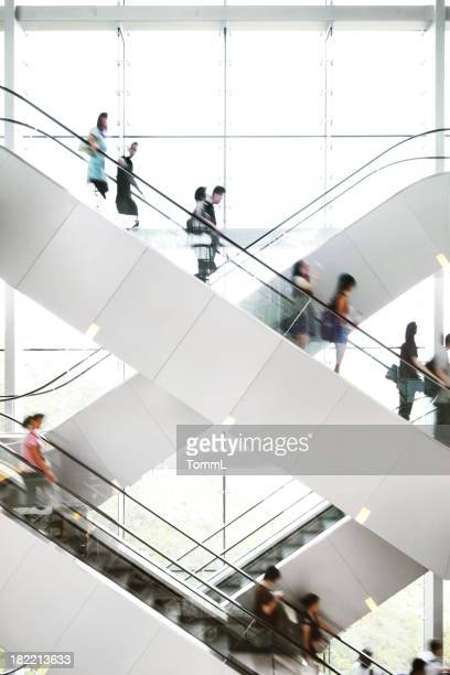 people on escalator - shopping mall stock pictures, royalty-free photos & images