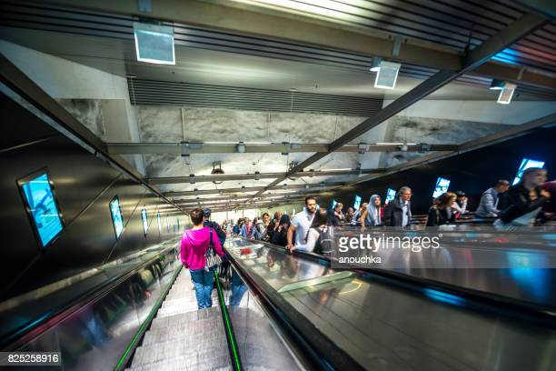 People on escalators, Helsinki subway, Finland