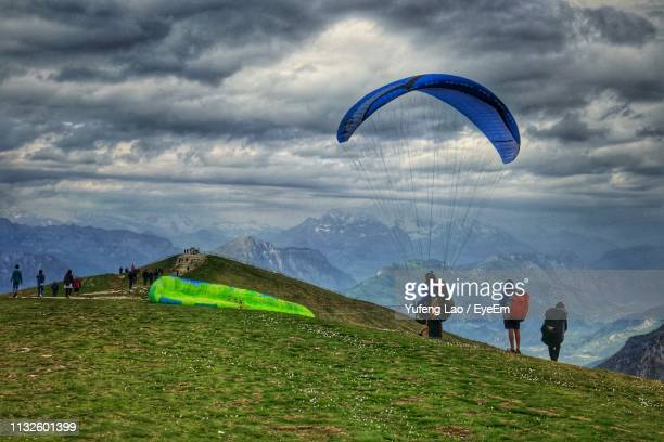 people on field against sky - malcesine stock pictures, royalty-free photos & images