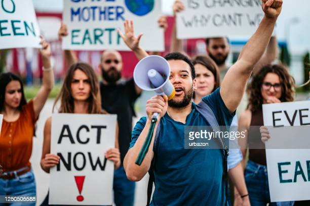 people on global strike for climate change - striker stock pictures, royalty-free photos & images