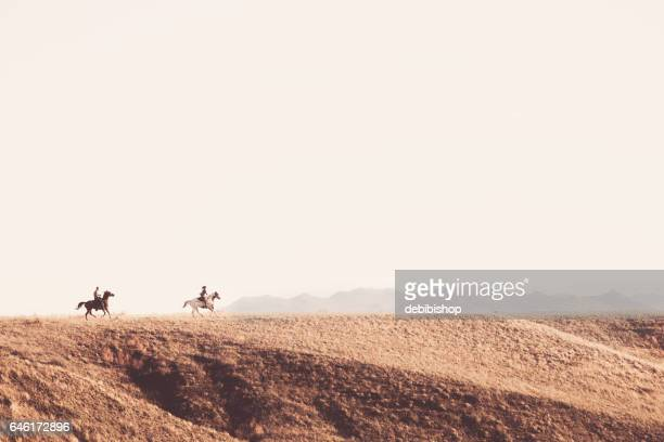 people on horseback outdoors - montana western usa stock pictures, royalty-free photos & images