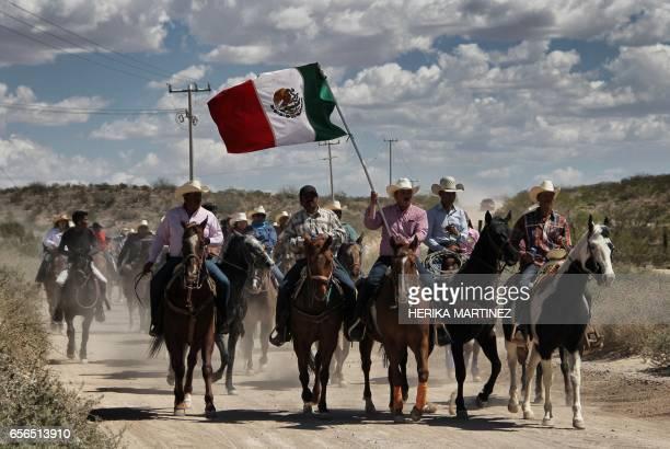 People on horseback take part in the Jornadas Villistas in honour of Mexican revolutionary leader General Francisco Pancho Villa in Ciudad Juarez...