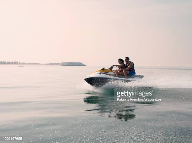 people on jet ski on vacation in the united arab emirates - ras al khaimah stock pictures, royalty-free photos & images