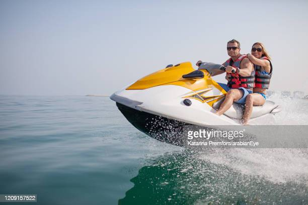 people on jet ski. - ras al khaimah stock pictures, royalty-free photos & images