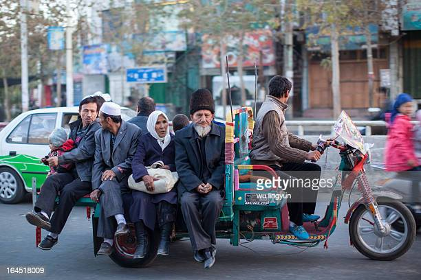 CONTENT] people on motor tricycle on Hotan streetsouth of Xinjiang
