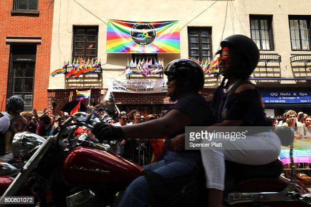 People on motorcycles make their way past the Stonewall Inn during the annual New York Gay Pride Parade one of the oldest and largest in the world in...