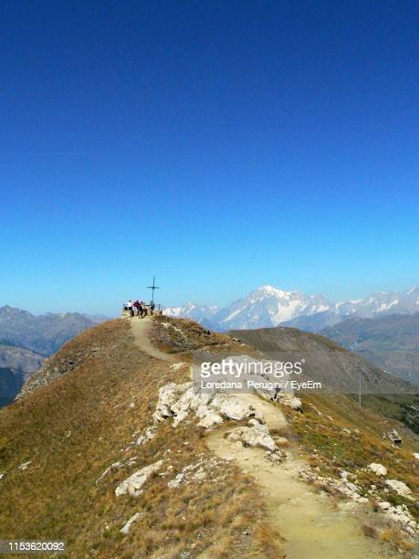 people on mountain against clear blue sky - loredana perugini stock pictures, royalty-free photos & images