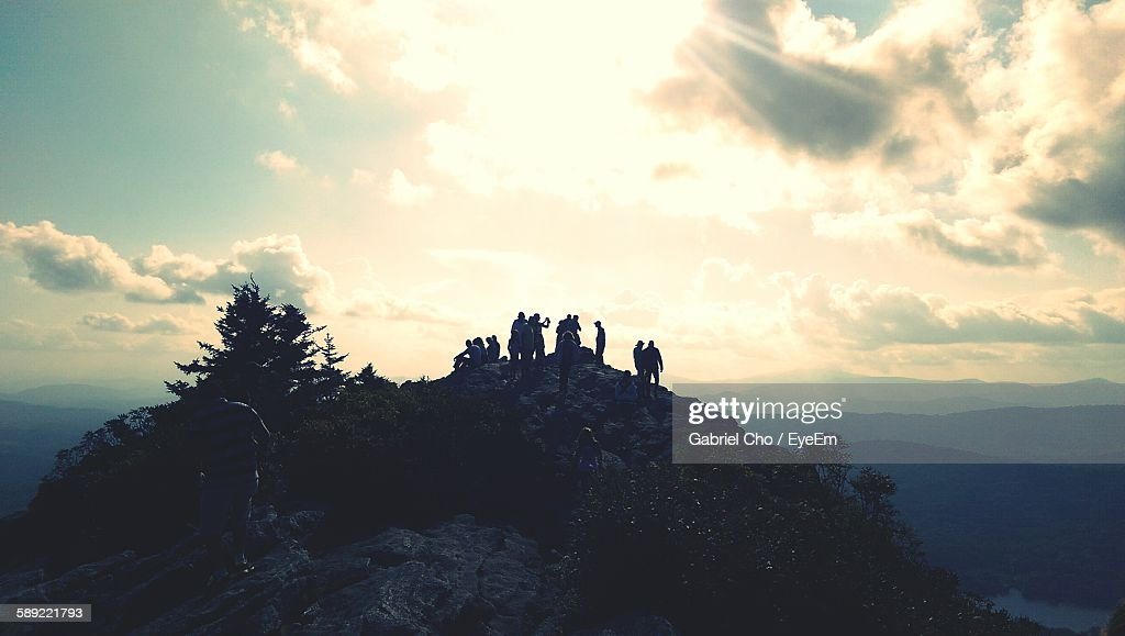People On Mountain Against Sky : Stock Photo