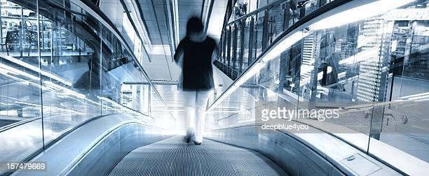 People on moving stairs in shopping center