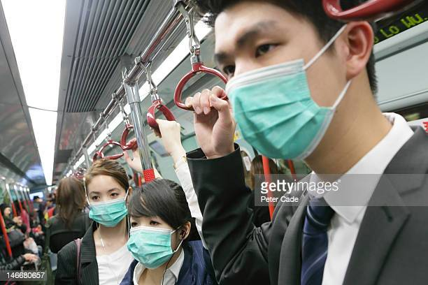 People on MTR wearing face masks