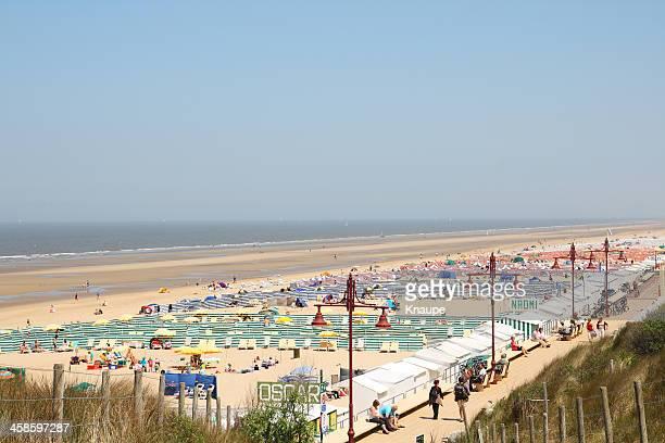 People on north sea beach at De Haan in Begium