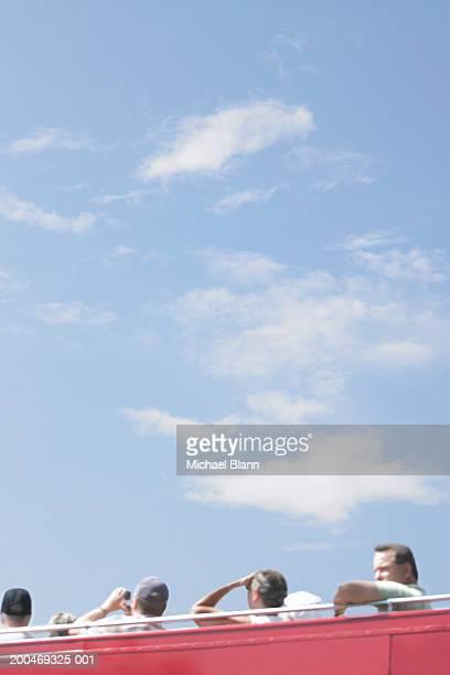 people on open roof bus - 上部分 ストックフォトと画像