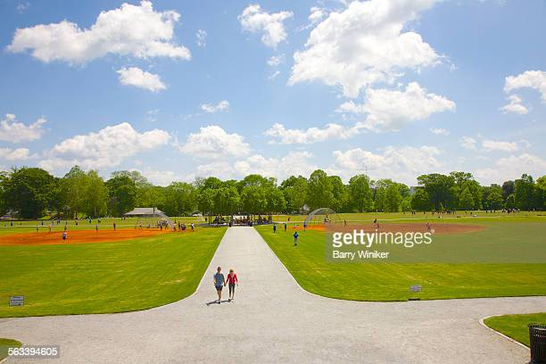 people on park path, atlanta - piedmont park atlanta georgia stock pictures, royalty-free photos & images