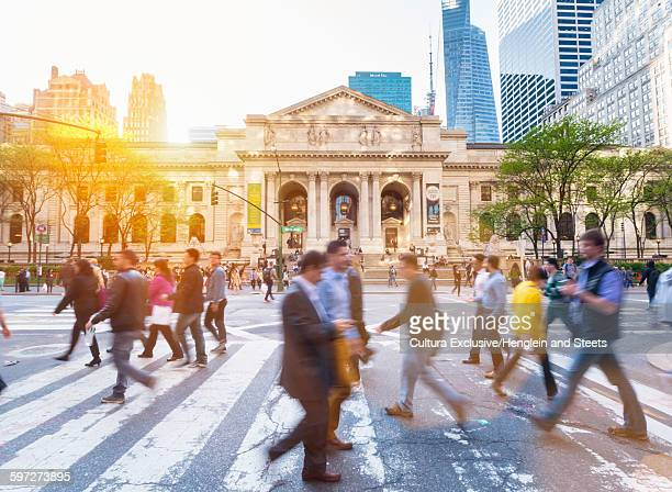 People on pedestrian crossing in front of New York Public Library, New York City, New York, USA