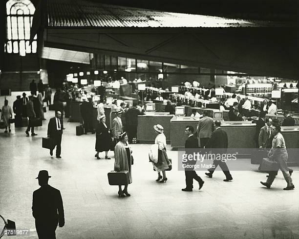 people on penn station, new york city, (b&w) - newark new jersey stock pictures, royalty-free photos & images