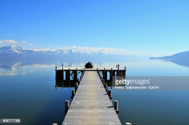 people on pier over lake - lake ohrid stock photos and pictures