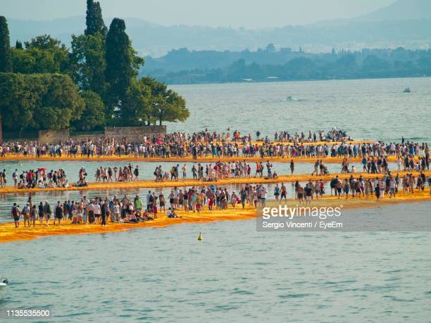 people on piers in sea - bergamo stock pictures, royalty-free photos & images