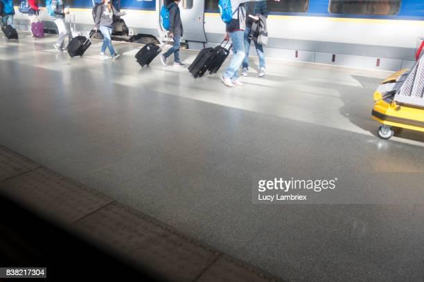 People on platform of international train