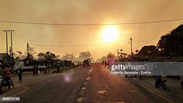 people on road against sky during sunset - mozambique stock pictures, royalty-free photos & images