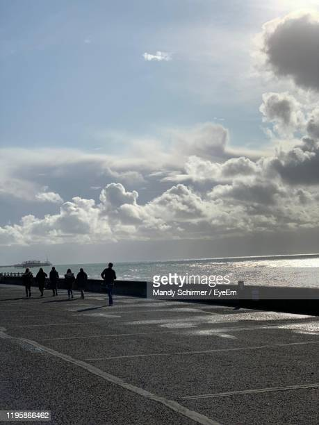 people on road against sky - mandy pritty stock pictures, royalty-free photos & images