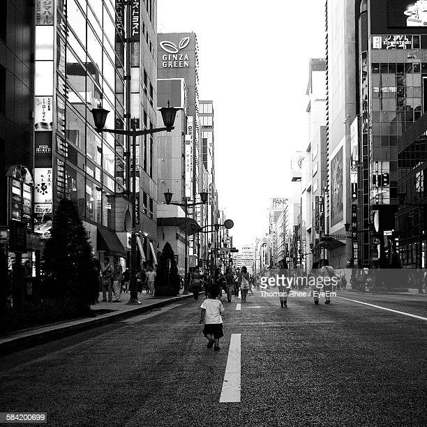 People On Road Amidst Buildings At Ginza