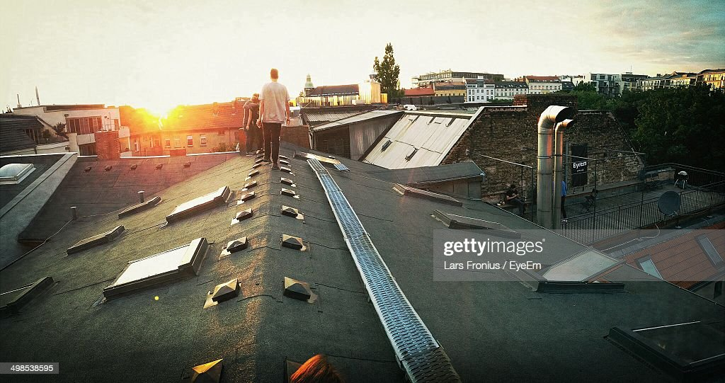 People on rooftop at sunset : Stock Photo
