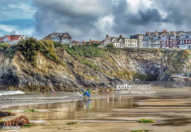 people on sandy beach - newquay stock pictures, royalty-free photos & images