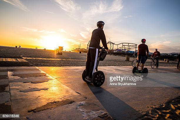 people on segway, santa monica beach, ca, usa - segway stock pictures, royalty-free photos & images